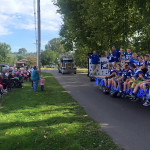 Football team going by on a float