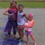 Three young girls with paint all over them