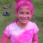 Young girl with pink paint all over her