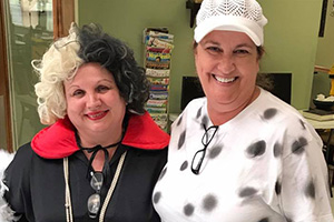 Two staff members dressed up for Halloween