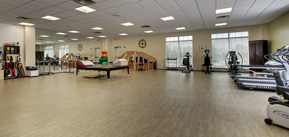 Expansive and well stocked rehabilitation therapy room at Valhalla Post Acute