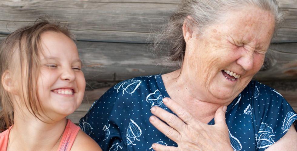 A grandmother and granddaughter laughing together