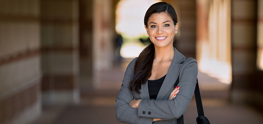 Business professional outside with her arms folded in front of her