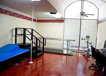 Rehabilitation room with clean, wood floors
