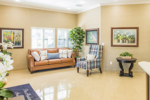 front lobby with plants, couches & chairs