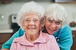 2 smiling women at the facility