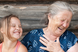 A grandmother and granddaughter laughing
