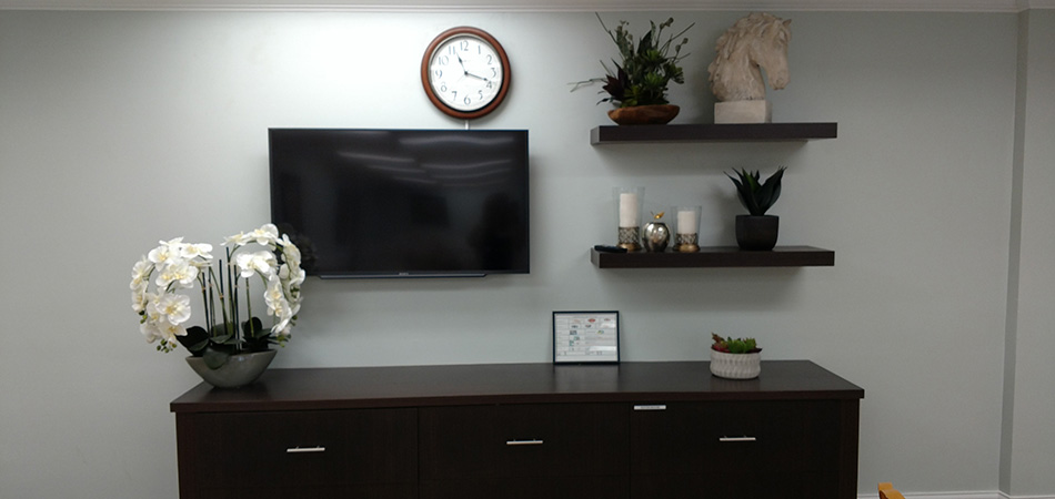 flat screen TV and a huge orchid plant