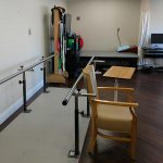 parallel therapy bars in an exercise room