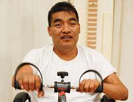 A resident working on rehab exercises in the rehab room.
