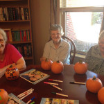 residents doing a halloween craft