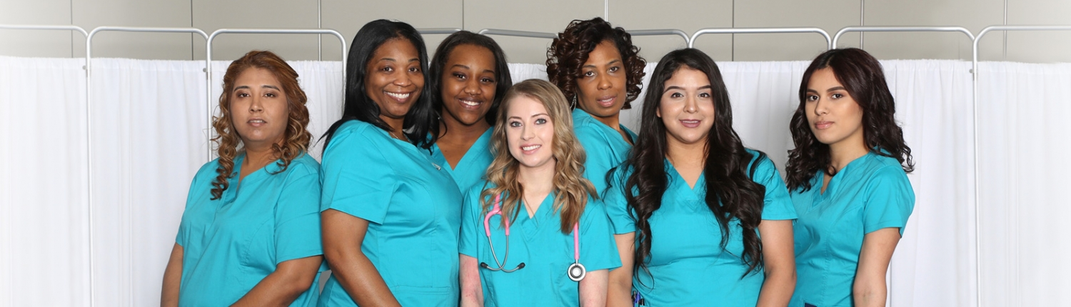 Staff photo of 7 nurses dressed in their blue scrubs