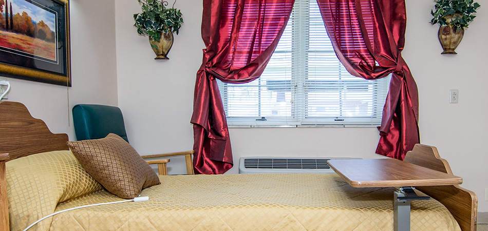 Resident room with blinds and nicely draped curtains