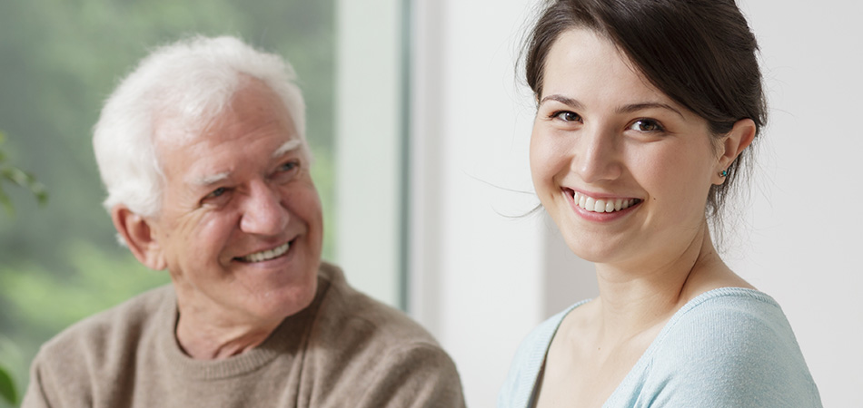 Grandfather and granddaughter laughing together