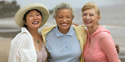 Three ladies outside smiling