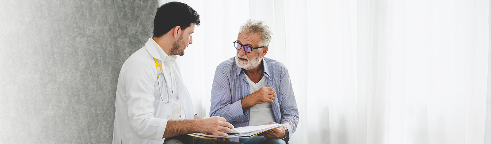 A doctor going over paperwork with a patient.