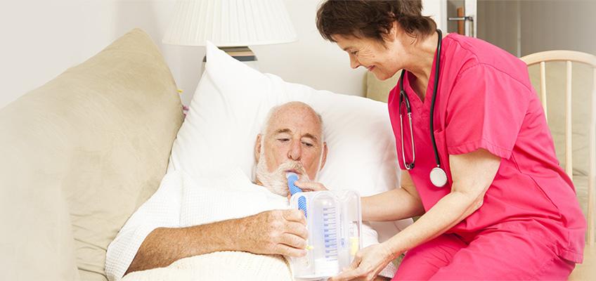 A nurse giving a man a breathing treatment