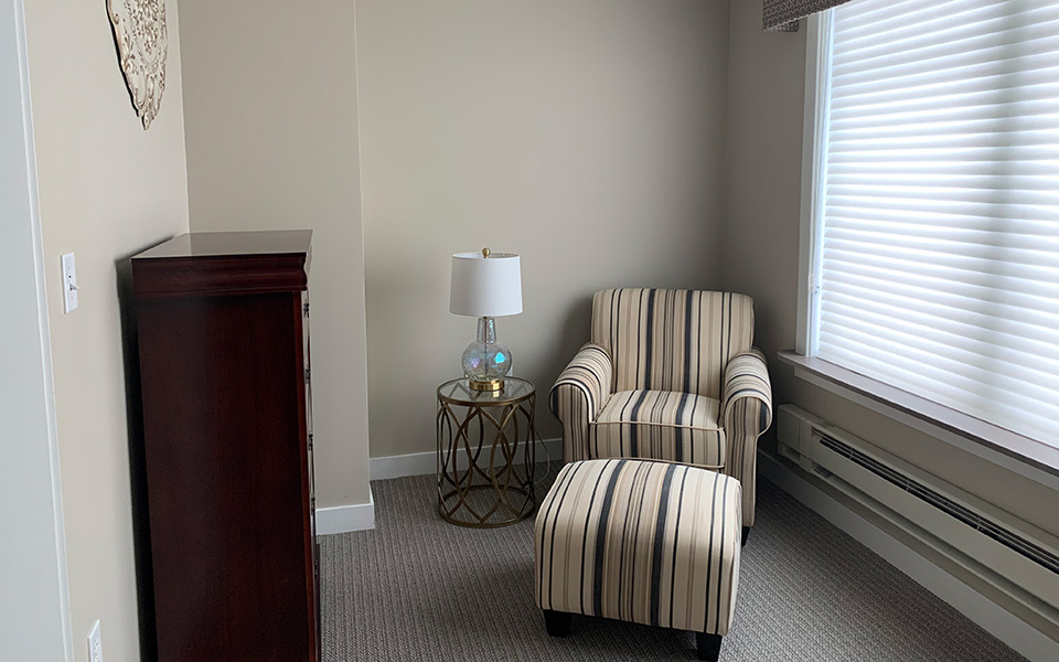 Sitting area beside the window.