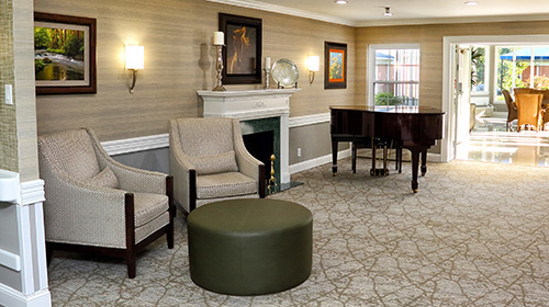 recreation room with grand piano and comfortable seating