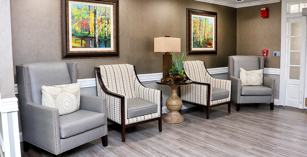 elegantly appointed lobby with upholstered chairs and artwork on the wall