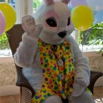 the easter bunny waving and ready for visitors