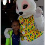a sweet young visitor giving the easter bunny a hug