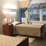 Double occupancy room with a large window to let in natural light.