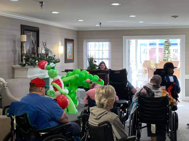 Residents listening to someone sing to them.