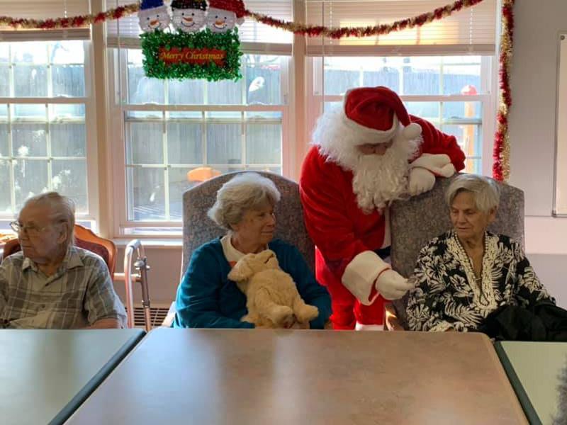 Santa visting residents.