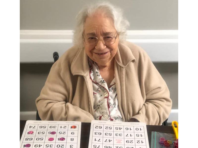 A resident playing Bingo.