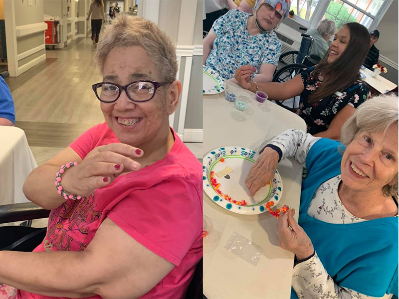 Residents showing off the bracelets they made.