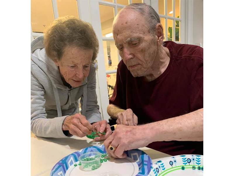 Residents beading together.