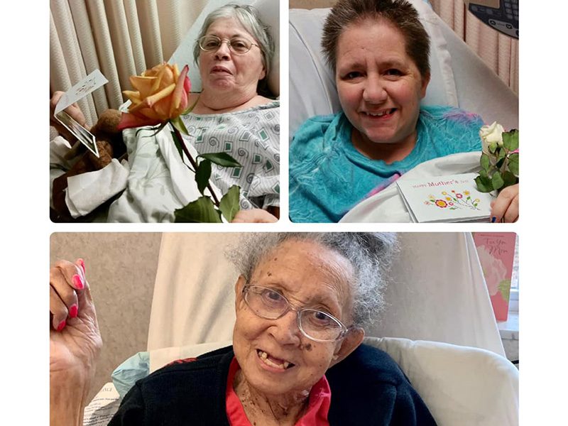 Residents smiling after receiving Mother's Day cards and flowers.