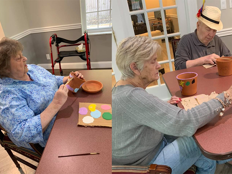 Residents painting pots together.