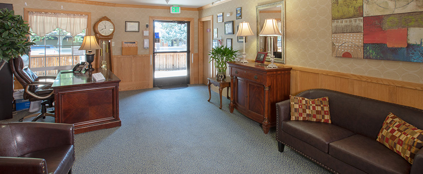 Resident lounge area with comfortable seating and clean floors