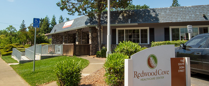 Redwood Cove entrance with handicapped access and the Redwood Cove Healthcare Center sign out front