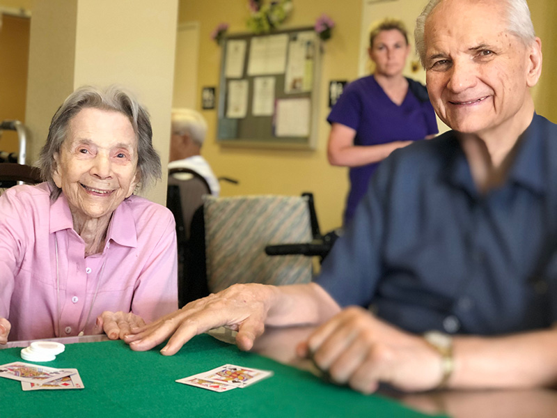 A man and woman playing cards together.