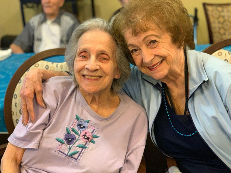 Two women smiling together.