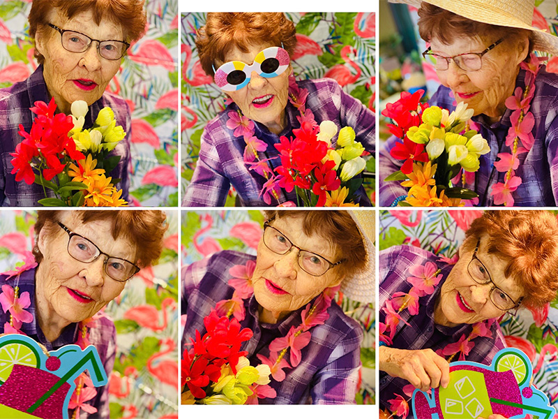Beautiful resident switches her look from glasses to sun glasses as she holds flowers, wears a flower necklace, and holds fun props in a Hawaiian themed photoshoot