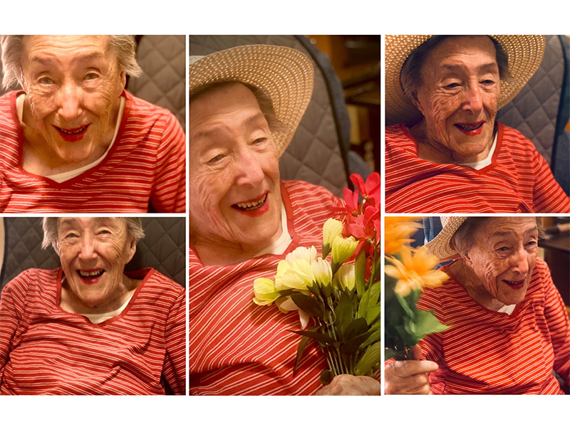 lovely resident wearing fun hat and holding flowers in a photoshoot