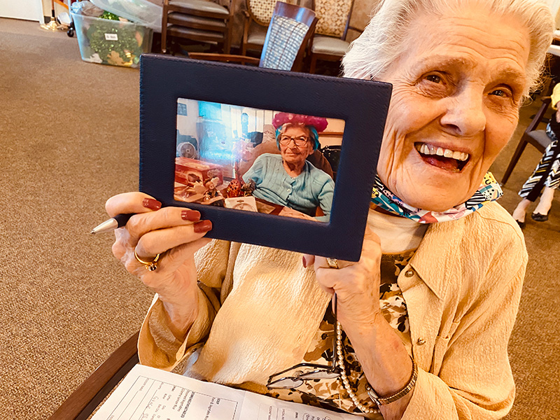 A resident holding up an image of a loved one.