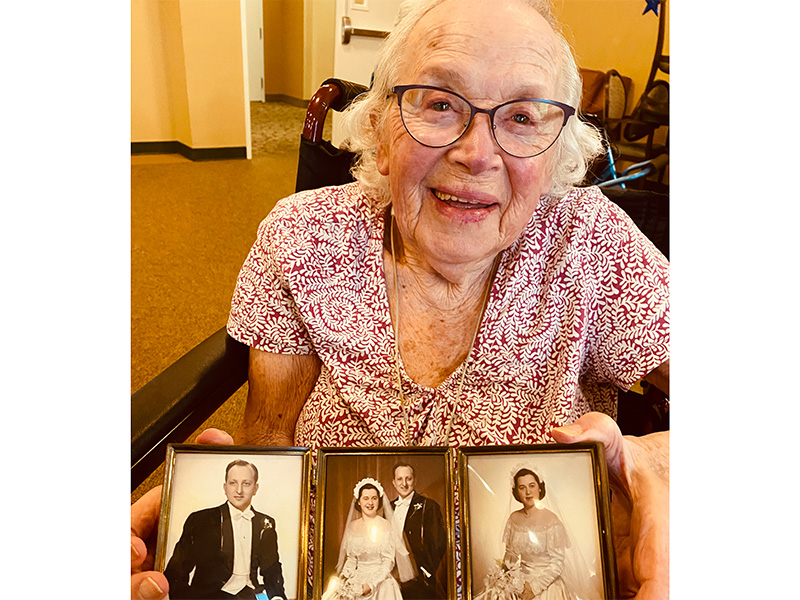 A resident showing her wedding photos.