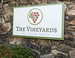 The Vineyards sign hanging on the outside of the building