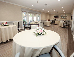 The Vineyards dining room with cream color table cloths and fresh flowers on every table