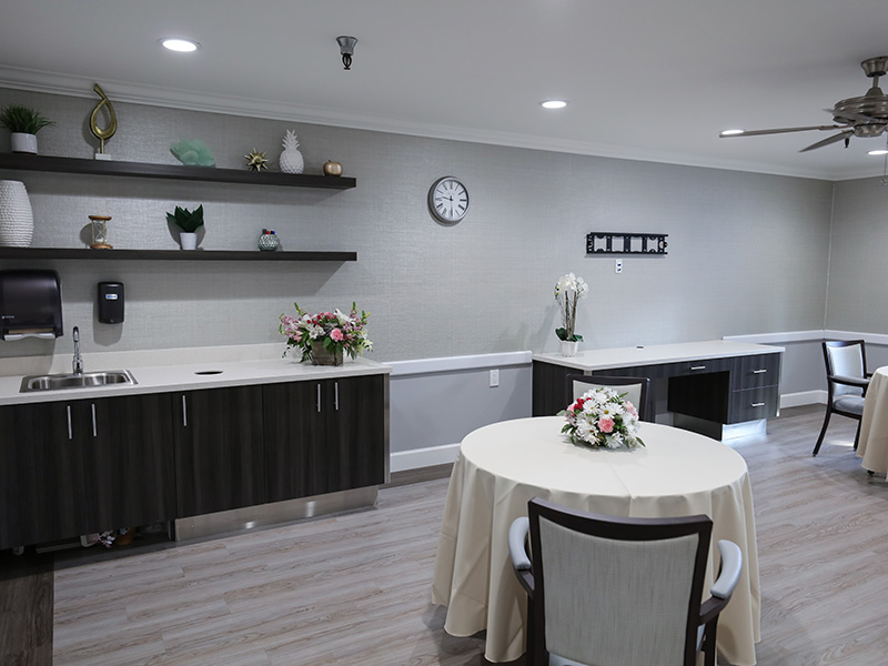 Dining room tables and buffet station with flowers and modern decor