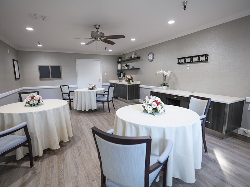 Dining room and buffet serving areas with fresh flowers on every table