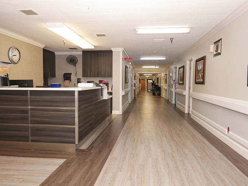 Recently remodeled hallway with wood flooring