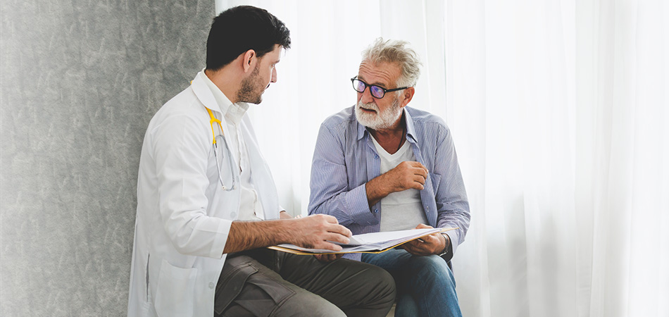 A patient and a doctor consulting over paperwork