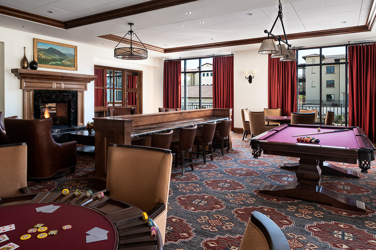 Very classy game room with many table and different games throughout