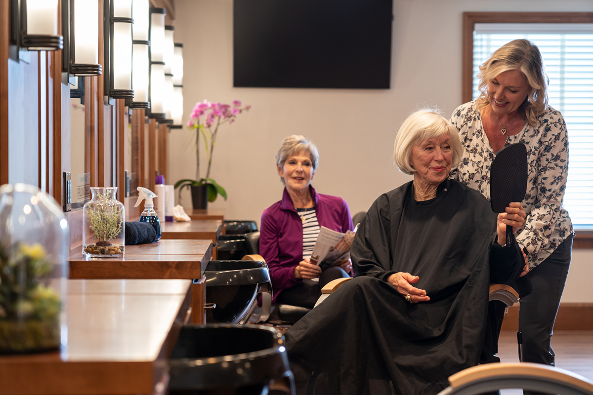 Two residents getting their hair done at the facility